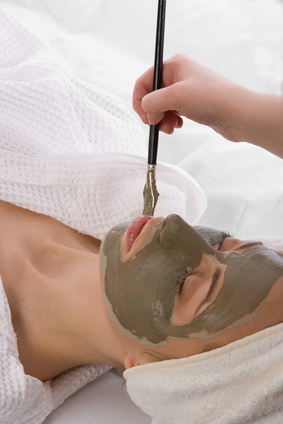 application of clay mask in a beauty center